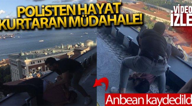 Teras kattan atlamaya çalışan genci polis anlık müdahaleyle kurtardı